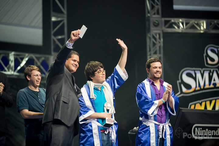 Nintendo of America President Reggie Fils-Aime waves to the crowd with competitive Smash players ZeRo, PPMD and Hungrybox.