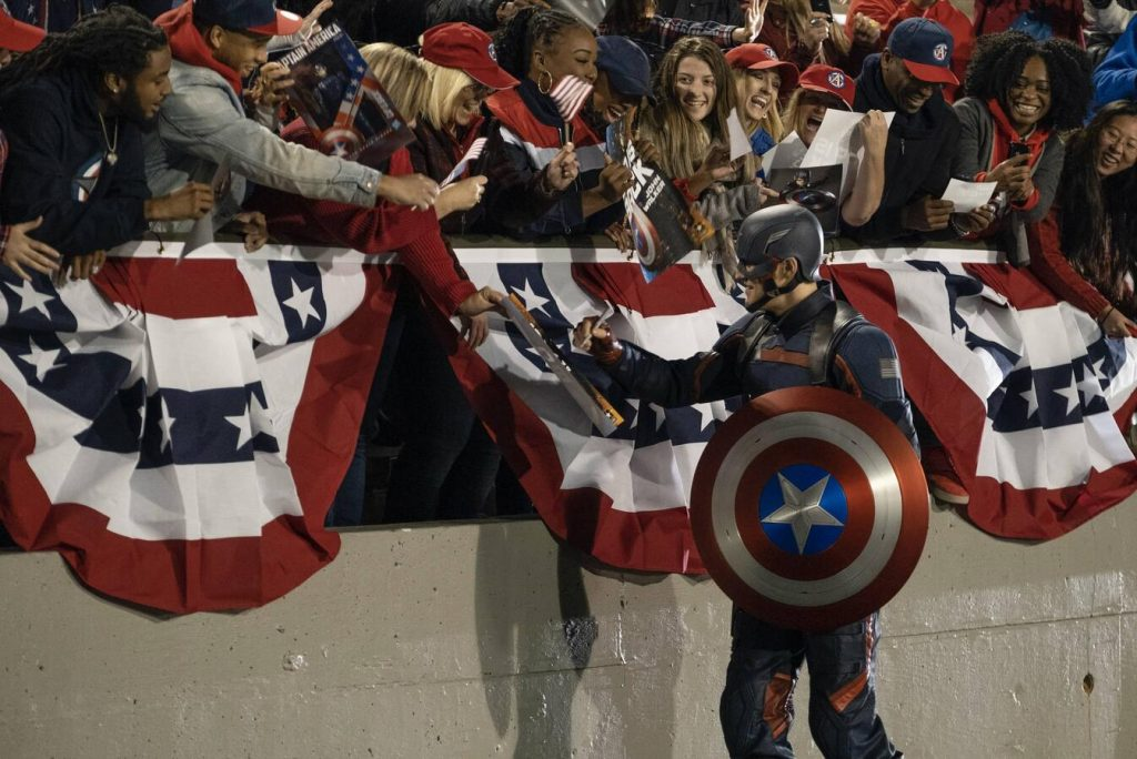 John Walker shakes hands as the new captain america